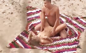 Horny couple oral sex and fucking on hot sand