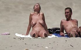 Milf tanning naked on nudist beach