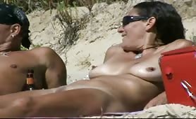Mature wife naked and happy on the beach