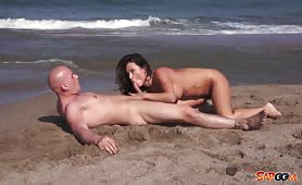 Latin milf sucks on a beach